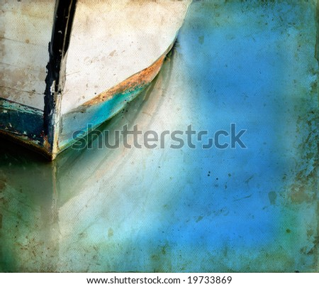 Bow of an old boat reflecting in the water. Copy-space for your own text. - stock photo