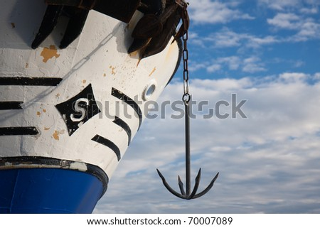 Bow of big ship with an anchor - stock photo