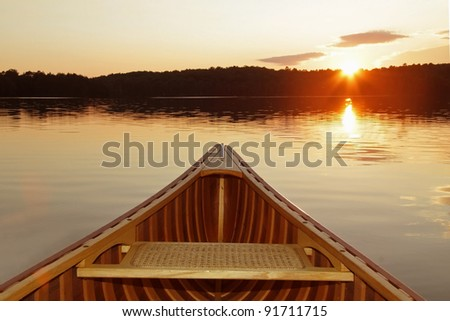 Bow of Cedar Canoe on a Canadian Lake at Sunset - stock photo
