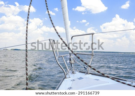 Bow of the Small Yacht Under Sailing On Open Waters. Horizontal Image Orientation - stock photo