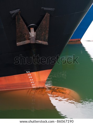 bow of two ships with draft scale numbering - stock photo