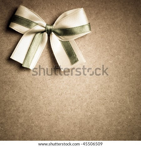 bow on a wooden background - stock photo