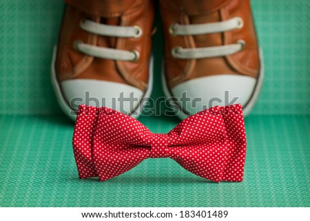 Bow tie and  sneakers - stock photo