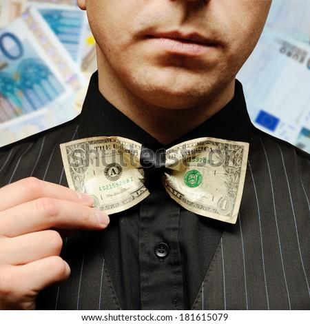 bow tie  made from dollar note and businessman - stock photo