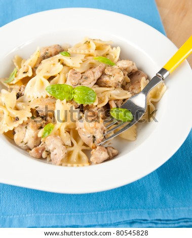 Bow-tie Pasta and Grilled Chicken Lunch - stock photo