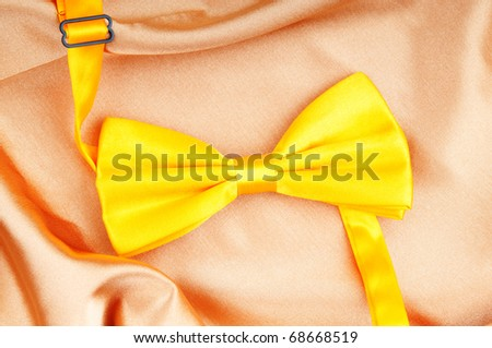 Bow ties on the bright satin background - stock photo