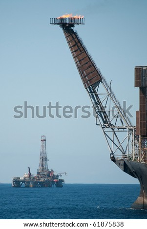 Bow view of an FPSO ol rig in offshore area.  Another drilling rig as background.  Coast of Brazil, 2010. - stock photo