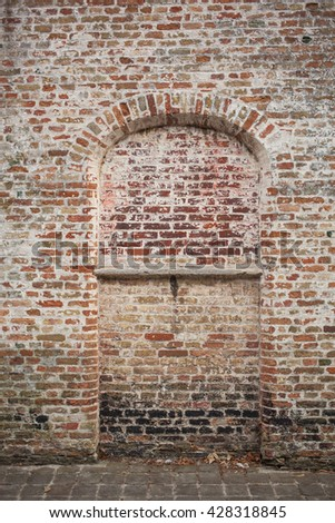 bow window on brick wall - stock photo