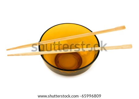 Bowl and chopsticks isolated on white background - stock photo