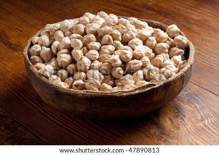 bowl Chick-Pea on wood - stock photo
