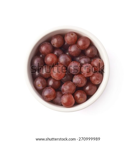 Bowl filled with the dark red grapes isolated over the white background, top view above foreshortening - stock photo