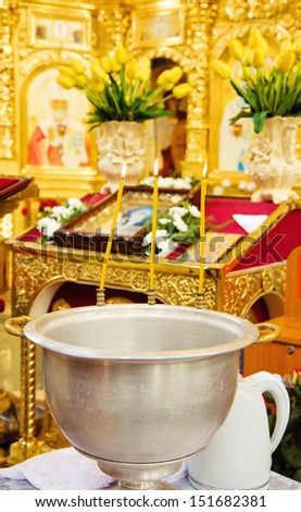 Bowl for christening ceremony in orthodox church - stock photo