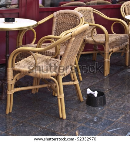 Bowl for pet food with dog bone on the ground in cafe - stock photo