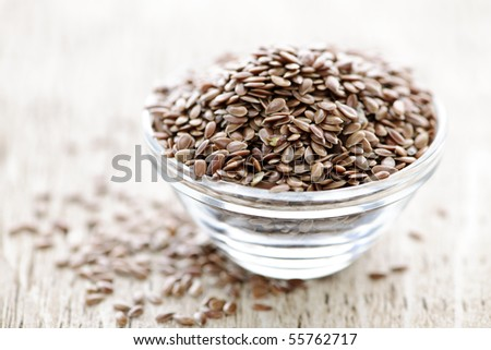 Bowl full of brown flax seed or linseed - stock photo