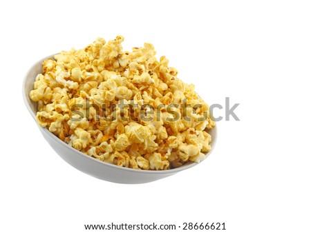 Bowl full of caramel popcorn isolated on white background. - stock photo