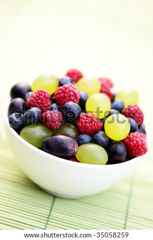 bowl full of delicious berry fruits - fruits and vegetables - stock photo