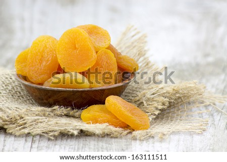 bowl full of dried apricots - stock photo