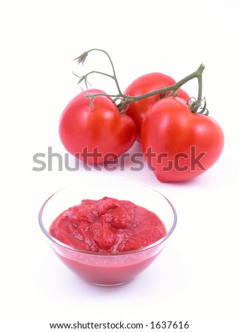 bowl full of ketchup and some fresh tomatoes on white