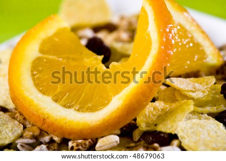 bowl full of muesli with fresh orange - shallow dof - stock photo