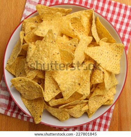 Bowl full of nacho corn chips. - stock photo
