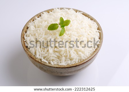 bowl full of rice ,A bowl of basmati rice garnished with mint,Starving Vege Rice - stock photo