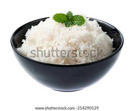 bowl full of rice with mint on white background - stock photo