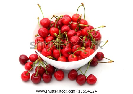 Bowl full of sweet cherries on a white background
