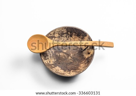 bowl made from Coconut shell with wooden spoon on white background