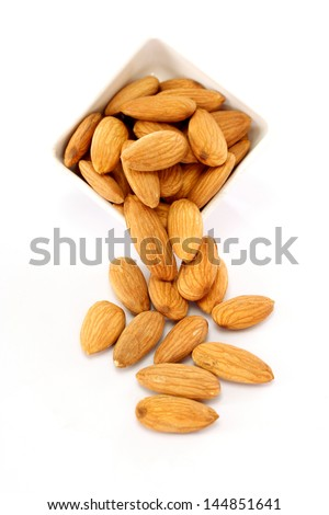 Bowl of almonds  on white - stock photo