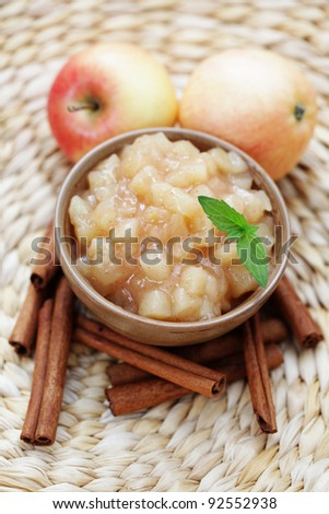bowl of apples with cinnamon - goods in jar /shallow DOF/