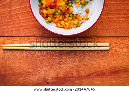 Bowl of Asian sticky rice with vegetable sauce - stock photo