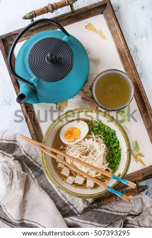 Bowl of asian style soup with noodles, egg, spring onion and tofu ...