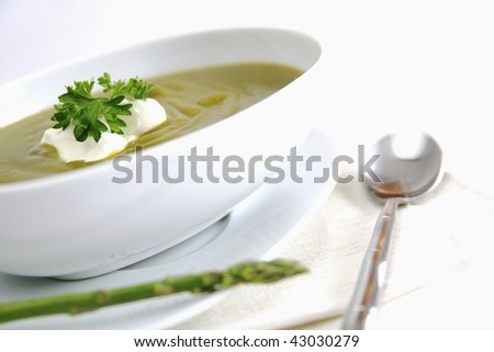 Bowl of asparagus soup with spoon - stock photo