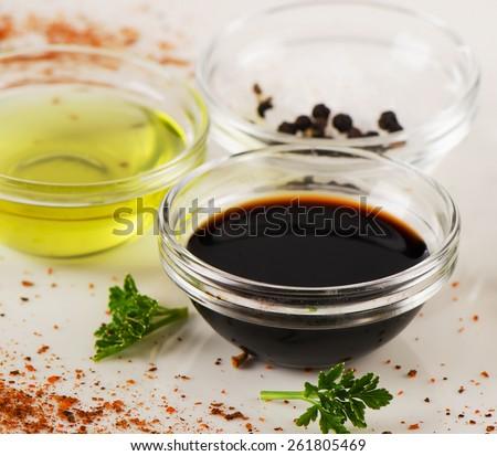 Bowl of Balsamic vinegar, salt and olive oil. - stock photo