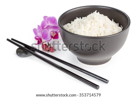 bowl of basmati rice, chopsticks and orchid flower - stock photo
