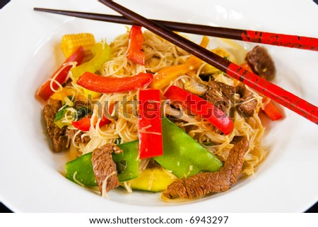 Bowl of beef and asian vegetable stirfry with vermicelli - stock photo