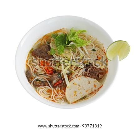 Bowl of beef rice vermicelli noodle soup, bun bo, Vietnamese cuisine - stock photo