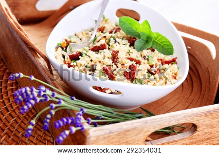 bowl of bulgur salad  with dry tomato - food and drink - stock photo