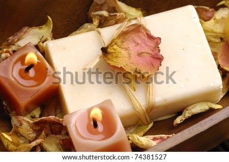 Bowl of burning candle with natural handmade with rose withered petals - stock photo