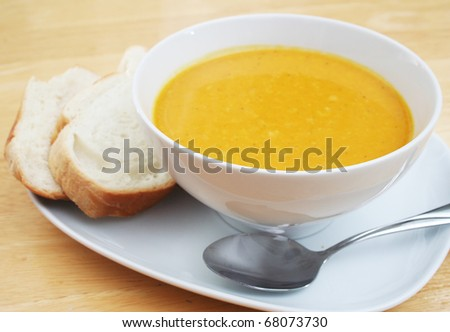Bowl of Butternut Squash Soup with Bread Slices - stock photo