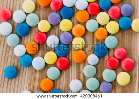 Bowl of candy coated chocolate. - stock photo