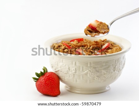 Bowl of cereal milk and strawberries - stock photo