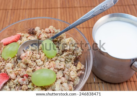 bowl of cereals with milk and fresh grapes - stock photo