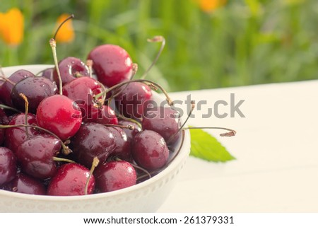 Bowl of cherry berries in on table closeup - stock photo