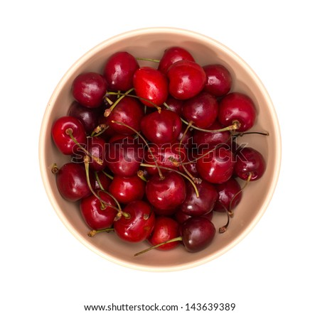 Bowl of cherry isolated on white top view - stock photo