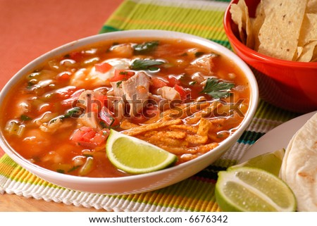 Bowl of chicken and tortilla soup with lime - stock photo