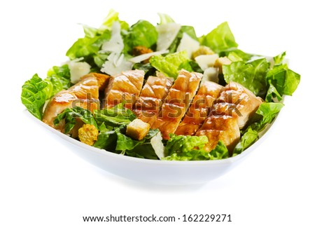 bowl of chicken salad on white background - stock photo