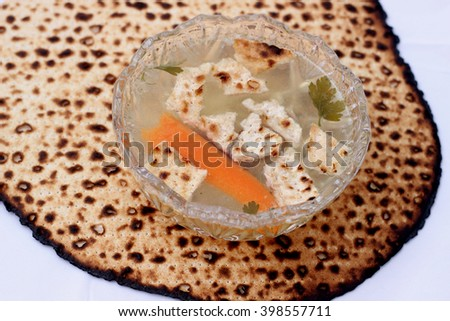 Bowl of chicken soup on a flat Matzah bread - traditional Passover food - stock photo