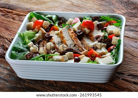 Bowl of Chiken Salad on the table wood - stock photo