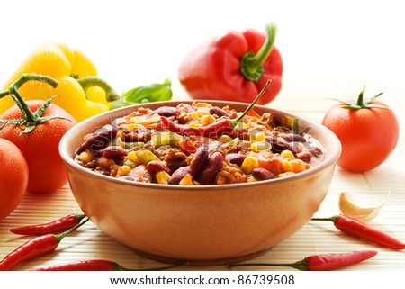 Bowl of chili con carne with ingredients - stock photo